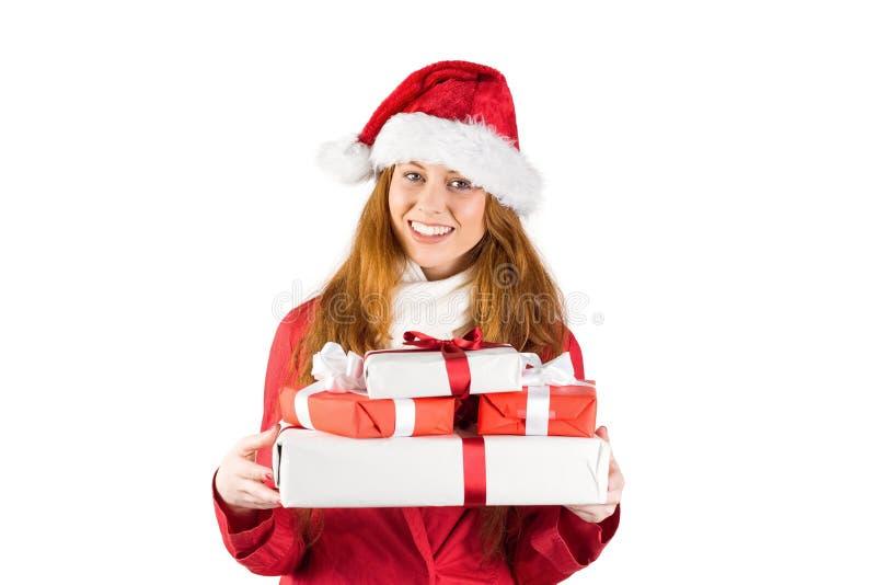 Εορταστικός redhead σωρός εκμετάλλευσης των δώρων στοκ φωτογραφία