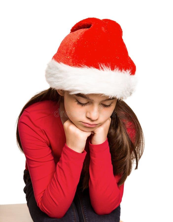 Εορταστικό μικρό κορίτσι που αισθάνεται λυπημένο στοκ εικόνες