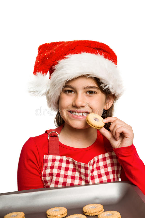 Εορταστικό μικρό κορίτσι που τρώει το μπισκότο στοκ φωτογραφία