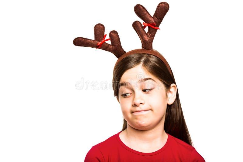Εορταστικό μικρό κορίτσι που φορά τα ελαφόκερες στοκ εικόνες