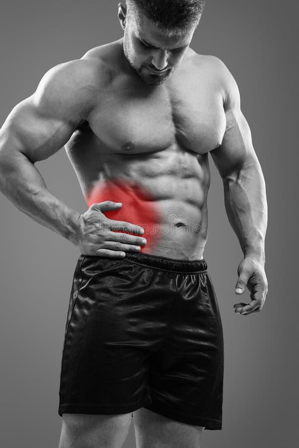 Επίθεση σκωληκοειδίτιδας Bodybuilder στοκ εικόνα
