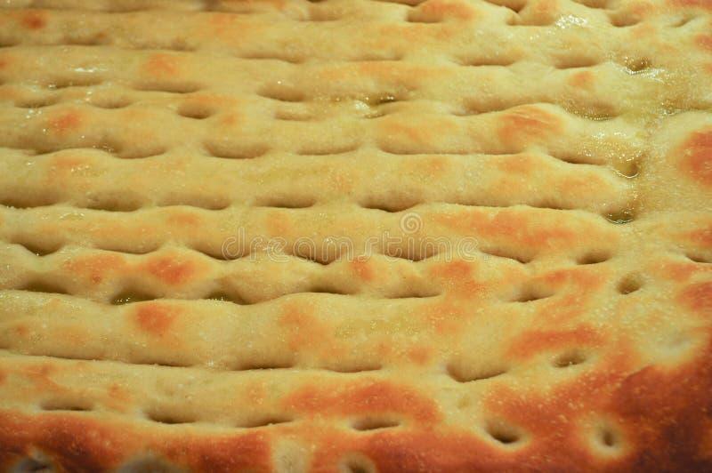 επίπεδα ψημένα ψωμί τρόφιμα focaccia στοκ φωτογραφία
