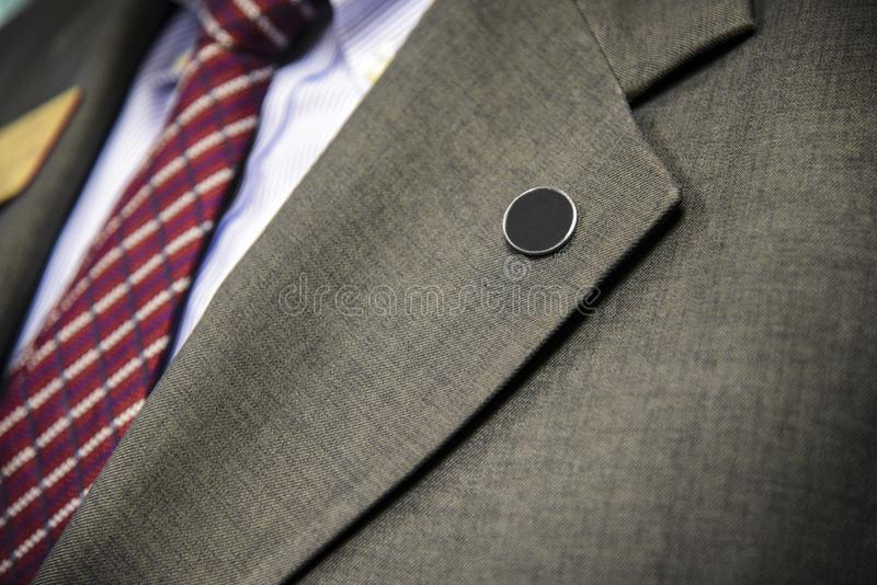 Επίσημη ένδυση παλτών και δεσμών επιχειρησιακών κοστουμιών πέτου στοκ εικόνες