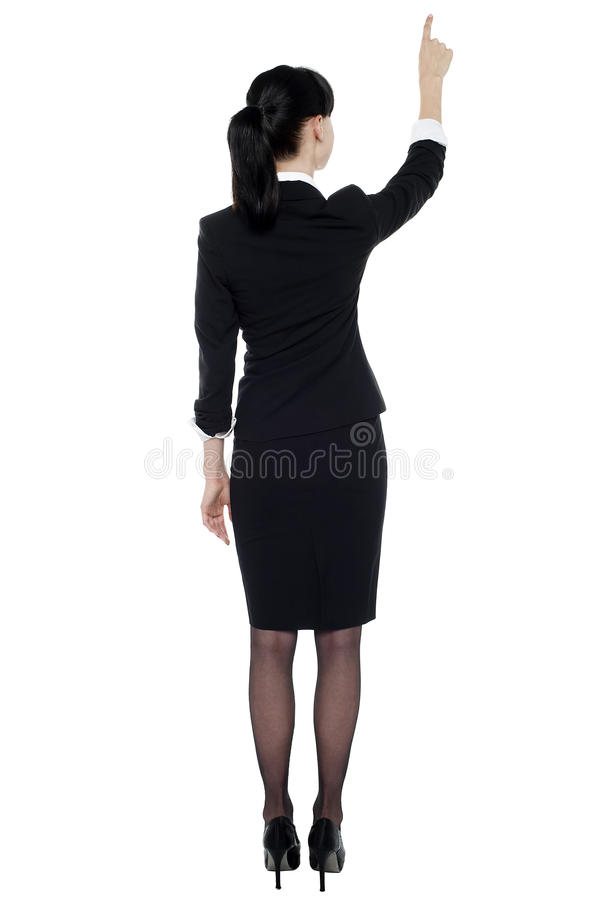 Επαγγελματική εταιρική κυρία που δείχνει στο διάστημα αντιγράφων στοκ φωτογραφία με δικαίωμα ελεύθερης χρήσης