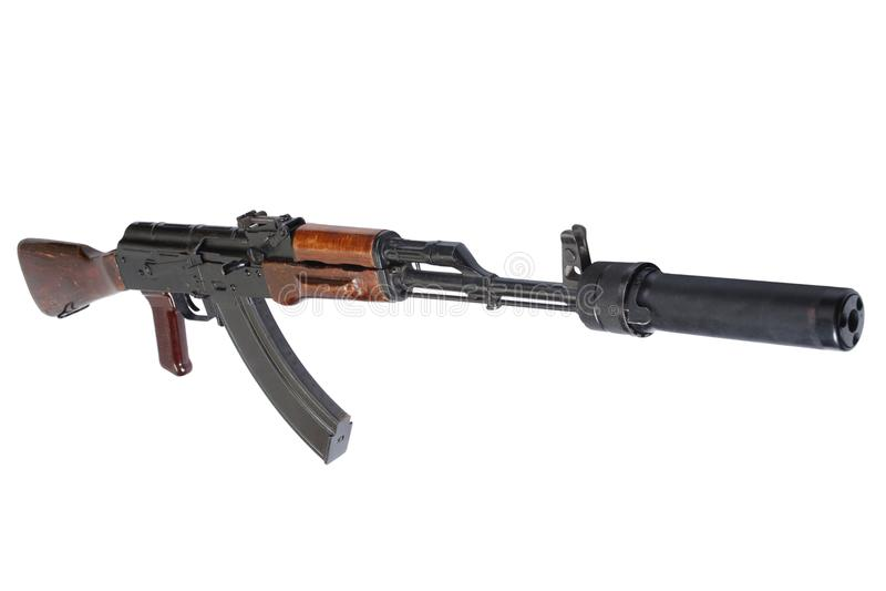 Επιθετικό τουφέκι AK 47 με τον υγιή καταπιεστή (ησυχαστήρας) στοκ φωτογραφία