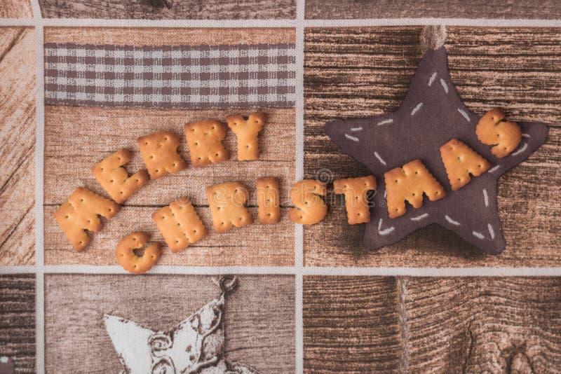 Επιθυμία Χαρούμενα Χριστούγεννας στο αναδρομικό ύφος στοκ φωτογραφίες με δικαίωμα ελεύθερης χρήσης