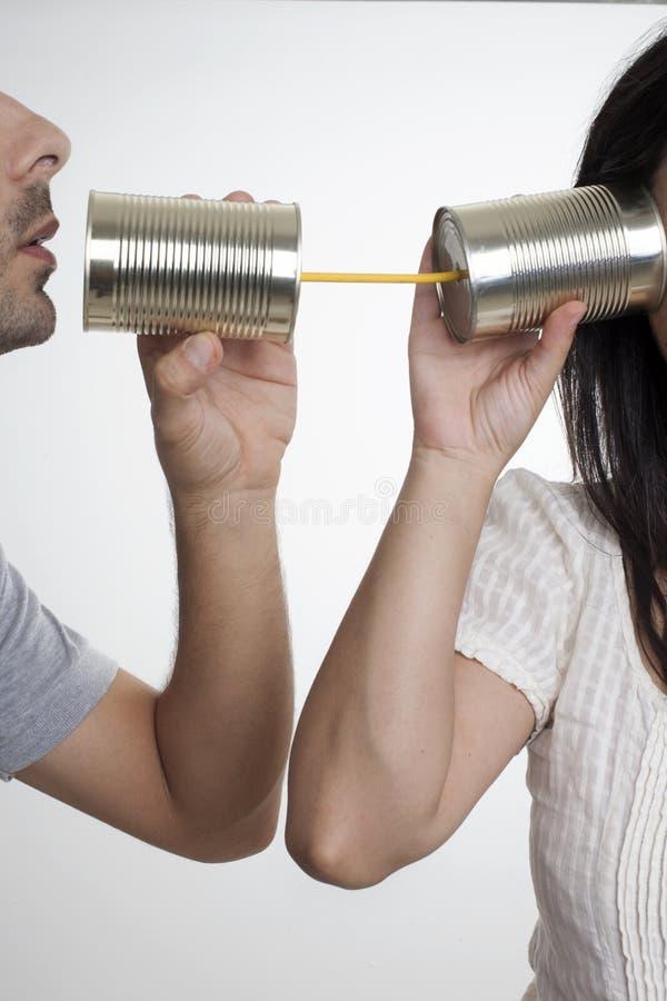 Επικοινωνία με τα δοχεία κασσίτερου στοκ εικόνες