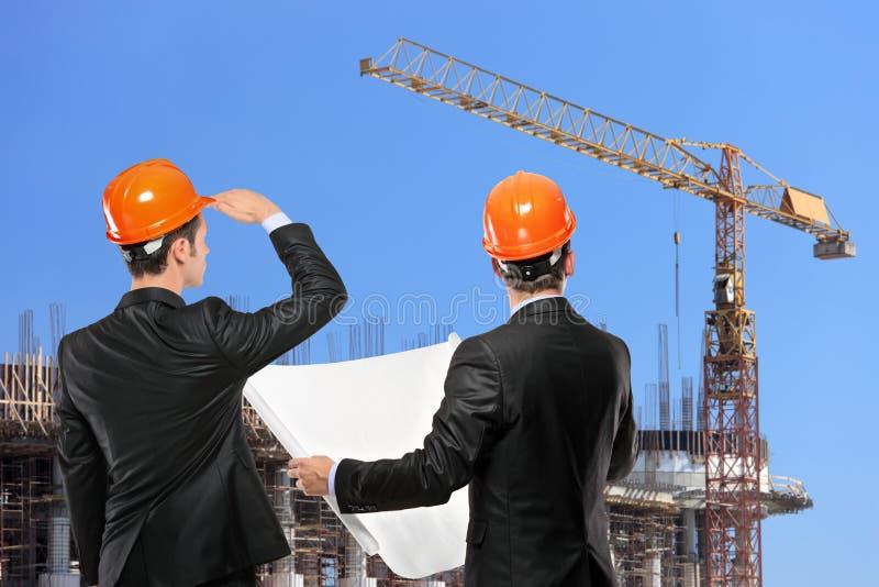 επιστάτες κατασκευής π&om στοκ εικόνα με δικαίωμα ελεύθερης χρήσης