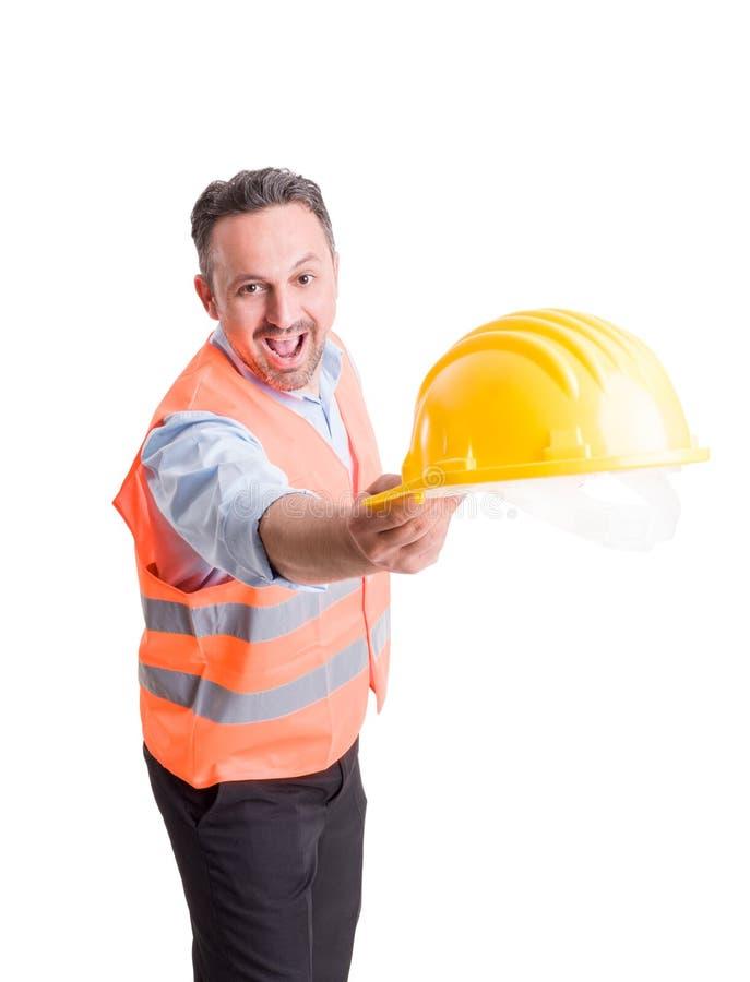 Επιστάτης ή μηχανικός που ρίχνει το καπέλο στοκ φωτογραφίες