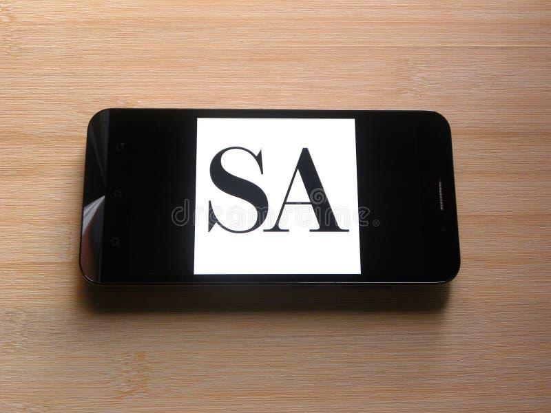 Επιστημονικός Αμερικανός στο κινητό τηλέφωνο στοκ εικόνες