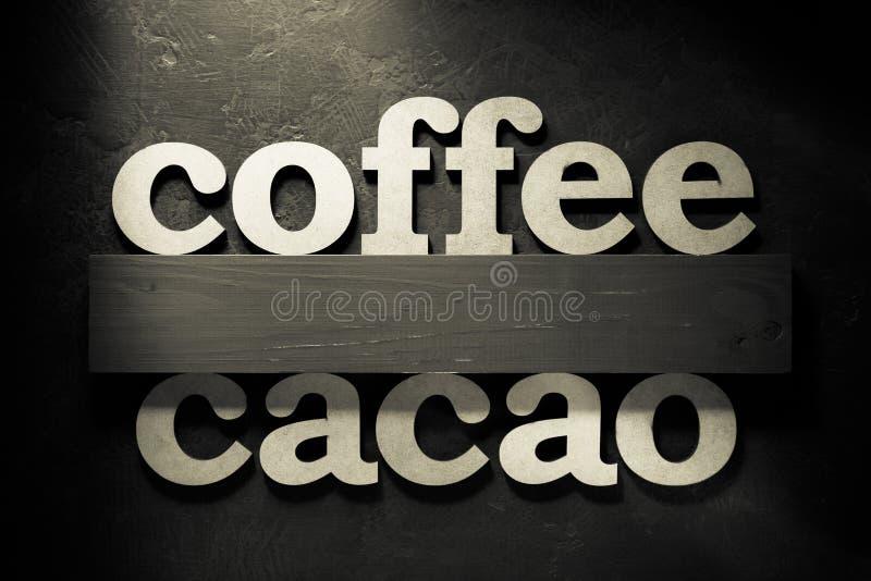 επιστολές καφέ και κακάου στο Μαύρο στοκ εικόνα