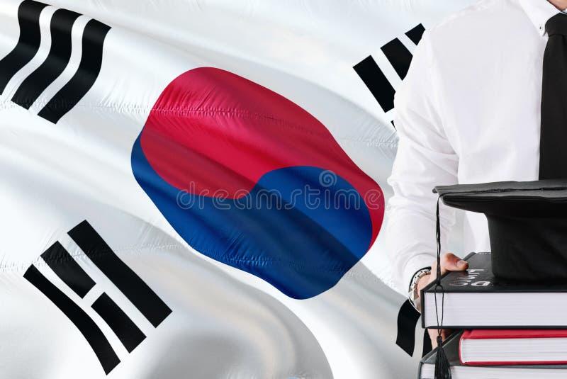 Επιτυχής νοτιοκορεατική έννοια εκπαίδευσης σπουδαστών Βιβλία και βαθμολόγηση ΚΑΠ εκμετάλλευσης πέρα από το υπόβαθρο σημαιών της Ν στοκ εικόνα