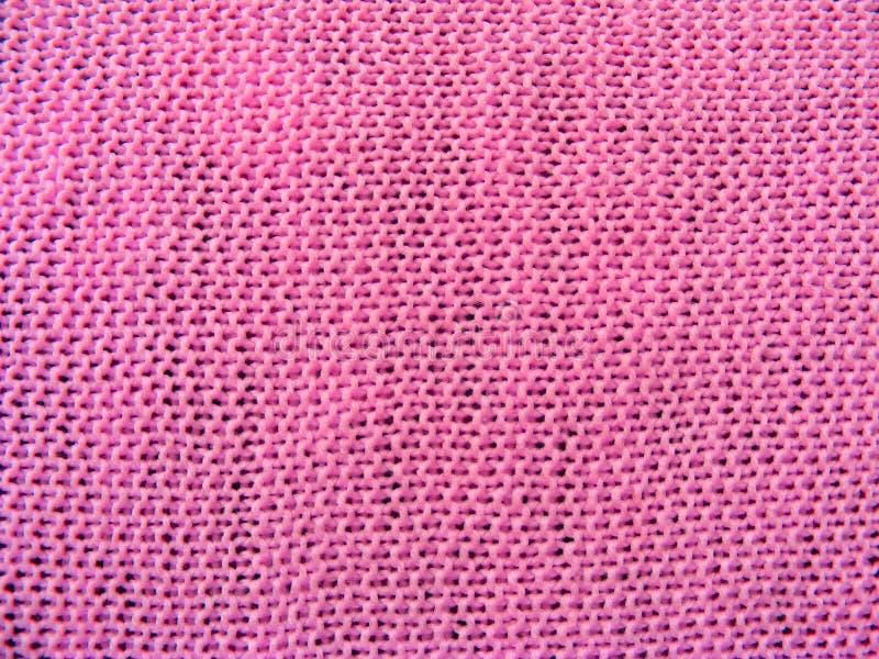 Επιφάνεια του βασικού πλεκτού υφάσματος puce στο ροζ στοκ φωτογραφία με δικαίωμα ελεύθερης χρήσης