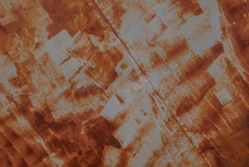 Επιφάνεια του σκουριασμένου σιδήρου με τα υπόλοιπα του παλαιού χρώματος, υπόβαθρο σύστασης στοκ εικόνες με δικαίωμα ελεύθερης χρήσης