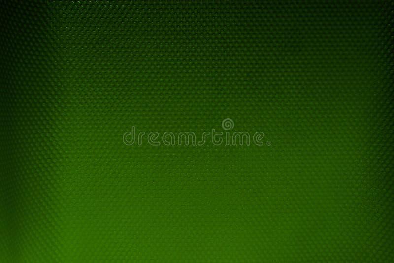 Επιφάνεια υποβάθρου του πράσινου και μαύρου πλαστικού υλικού με τα σημεία στοκ εικόνες