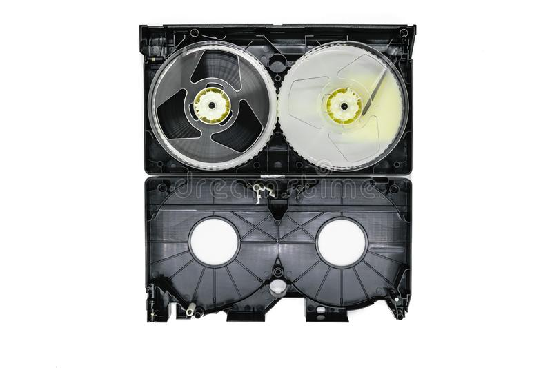 Επιφάνεια υποβάθρου των ανοικτών τηλεοπτικών εξελίκτρων ταινιών VHS εγχώριων συστημάτων εσωτερικών και του πλαστικού δίσκου που α στοκ φωτογραφίες