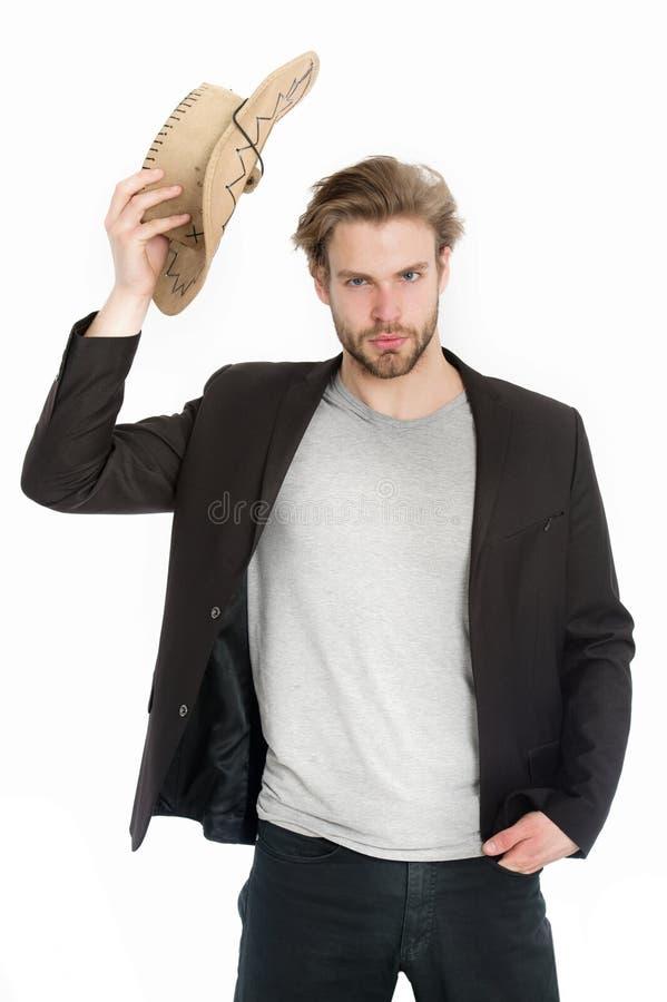 Επιχειρηματίας ή νεαρός άνδρας που φορά το καπέλο κάουμποϋ και το μαύρο σακάκι στοκ εικόνα