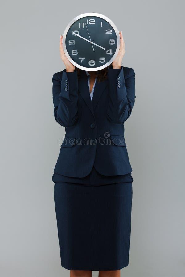Επιχειρηματίας με ένα ρολόι στοκ εικόνα με δικαίωμα ελεύθερης χρήσης