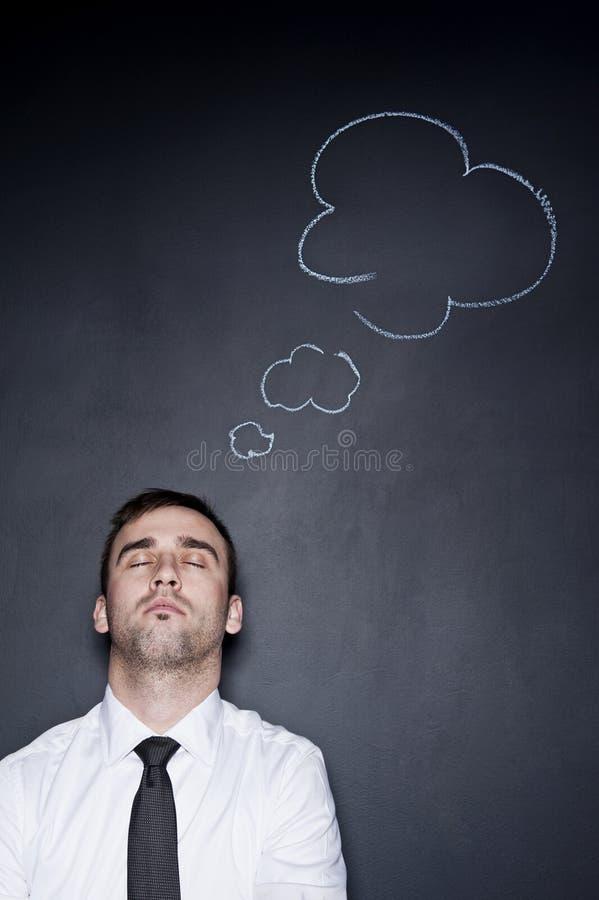 Επιχειρηματίας με ένα σκεπτόμενο σύννεφο στοκ φωτογραφίες