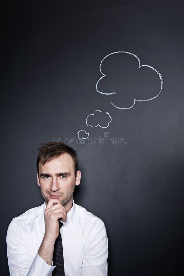 Επιχειρηματίας με ένα σκεπτόμενο σύννεφο στοκ φωτογραφία με δικαίωμα ελεύθερης χρήσης