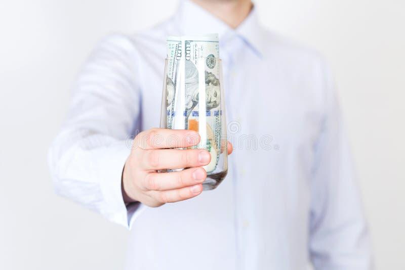 Επιχειρηματίας με τα δολάρια στοκ εικόνες