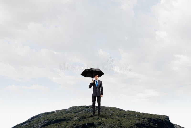 Επιχειρηματίας με την ομπρέλα στοκ φωτογραφία