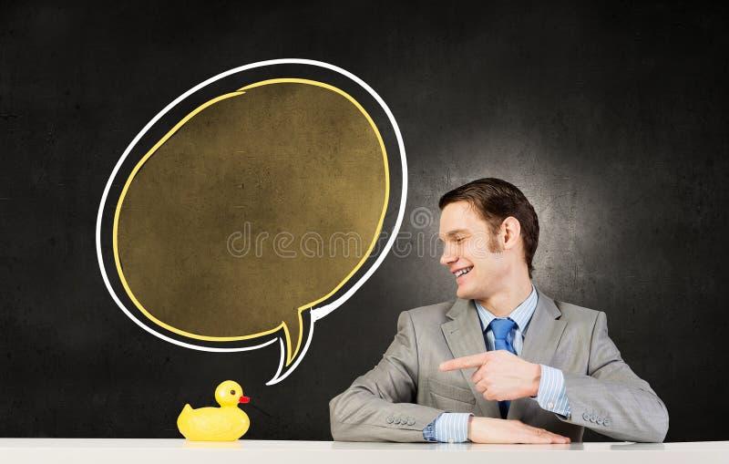 Επιχειρηματίας με την πάπια στοκ φωτογραφία