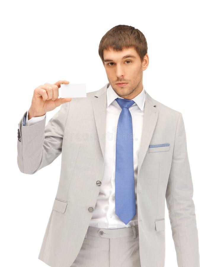 Επιχειρηματίας με τη επαγγελματική κάρτα στοκ εικόνα