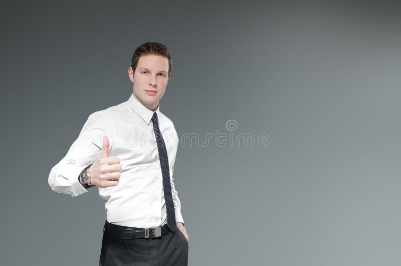 Επιχειρηματίας με τους αντίχειρες επάνω. στοκ εικόνες