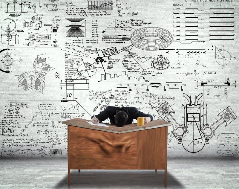 Επιχειρηματίας με το κεφάλι του στο γραφείο στοκ εικόνες