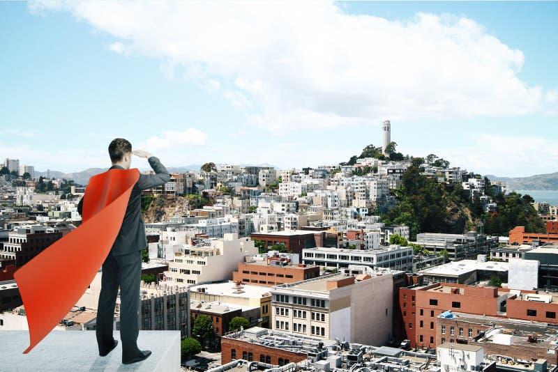 Επιχειρηματίας με το κόκκινο ακρωτήριο superhero στοκ φωτογραφία