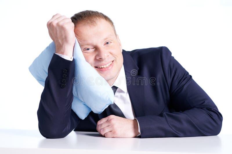 Επιχειρηματίας με το μαξιλάρι στοκ εικόνες