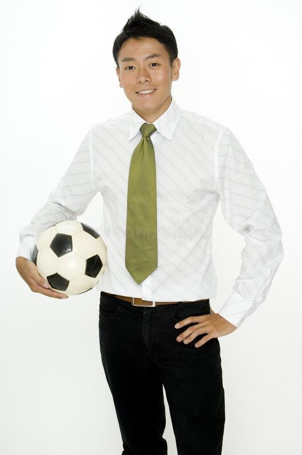 Επιχειρηματίας με το ποδόσφαιρο στοκ εικόνες