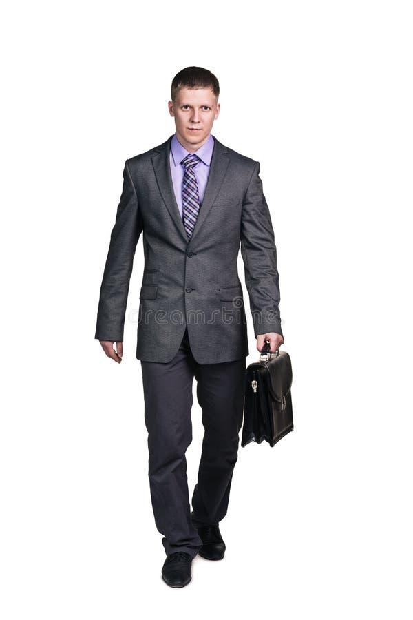 Επιχειρηματίας με το χαρτοφύλακα στοκ εικόνα