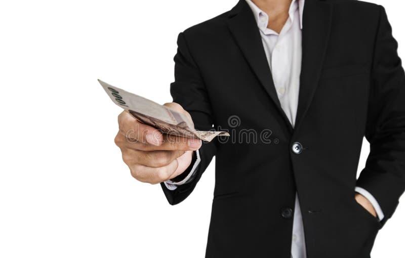Επιχειρηματίας που δίνει ή που λαμβάνει τα μετρητά, εκλεκτική εστίαση, που απομονώνεται στο άσπρο υπόβαθρο στοκ φωτογραφίες