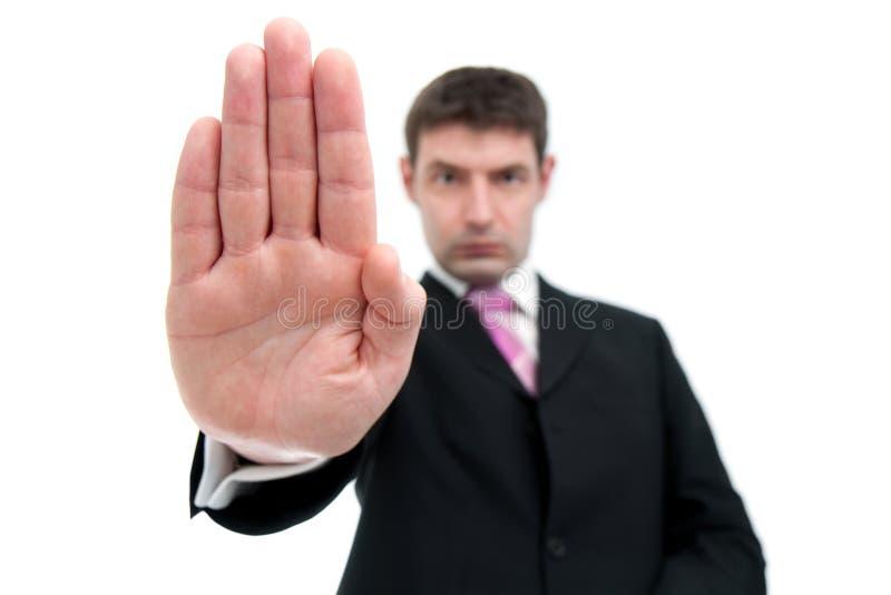 Επιχειρηματίας που δείχνει τη ΣΤΑΣΗ με το χέρι του στοκ εικόνες