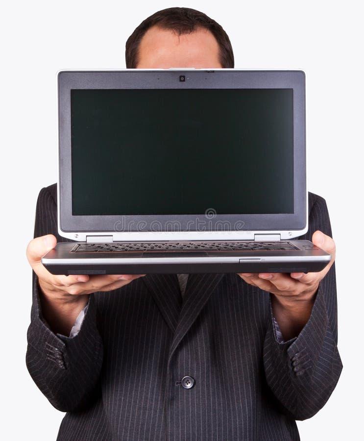 Επιχειρηματίας που κρατά ένα lap-top στοκ φωτογραφίες με δικαίωμα ελεύθερης χρήσης
