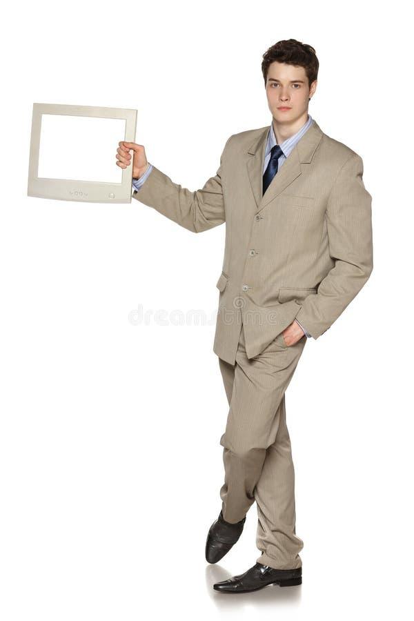 Επιχειρηματίας που κρατά τη TV/τη οθόνη υπολογιστή στοκ φωτογραφίες