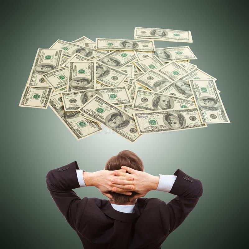 Επιχειρηματίας που ονειρεύεται για τα μετρητά χρημάτων, δολάρια, στοκ φωτογραφίες με δικαίωμα ελεύθερης χρήσης