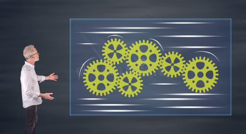 Επιχειρηματίας που παρουσιάζει μια έννοια ομαδικής εργασίας σε μια οθόνη τοίχων στοκ εικόνες