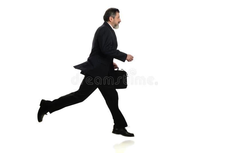 Επιχειρηματίας που περπατά σε μια βιασύνη στοκ εικόνες