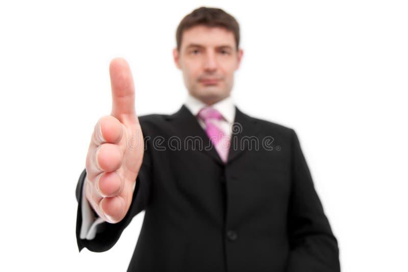 Επιχειρηματίας που προσφέρει μια χειραψία στοκ φωτογραφία