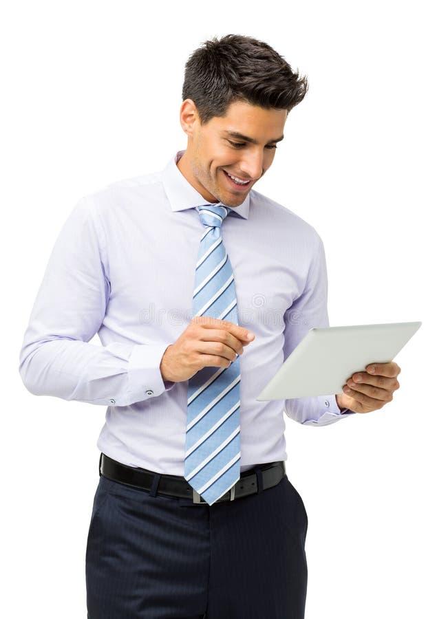 Επιχειρηματίας που χρησιμοποιεί τον υπολογιστή ταμπλετών στοκ εικόνες