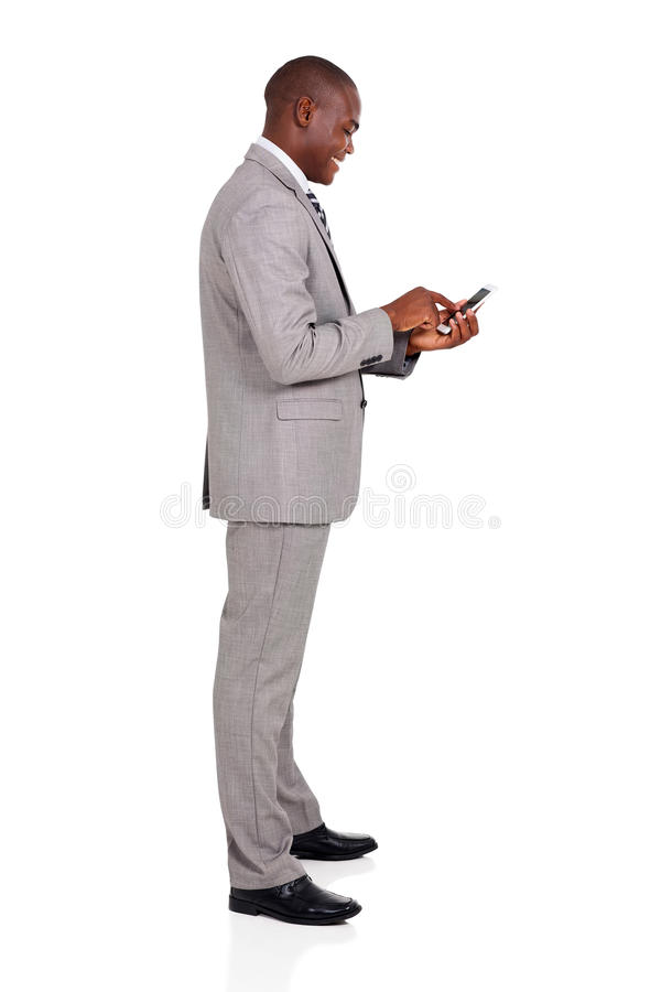Επιχειρηματίας που χρησιμοποιεί το έξυπνο τηλέφωνο στοκ εικόνα