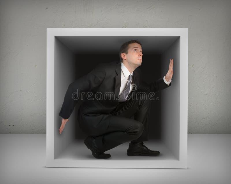 Επιχειρηματίας σε ένα κιβώτιο στοκ εικόνες