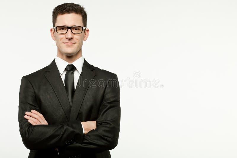 Επιχειρηματίας στο μαύρο κοστούμι στο λευκό. στοκ φωτογραφία με δικαίωμα ελεύθερης χρήσης