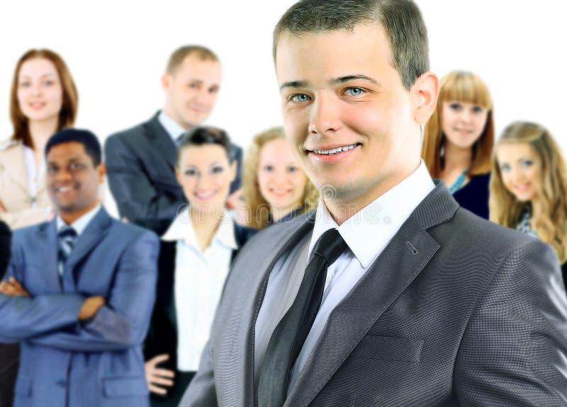 Επιχειρηματίας στο υπόβαθρο της επιχειρησιακής ομάδας στοκ φωτογραφία με δικαίωμα ελεύθερης χρήσης