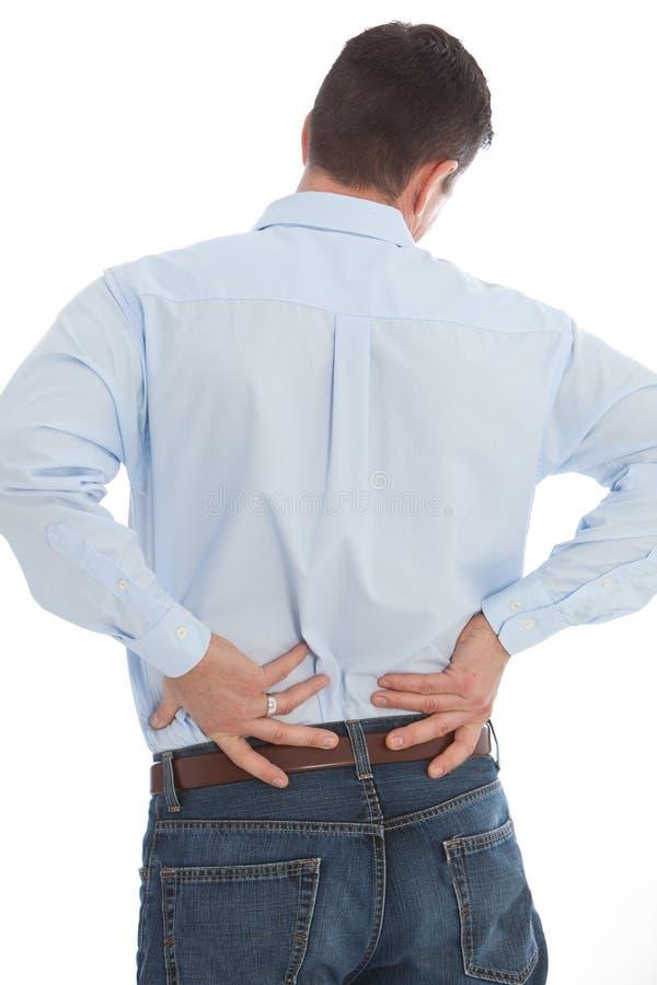 Επιχειρηματίας τον πόνο στην πλάτη που απομονώνεται που υφίσταται στο λευκό στοκ εικόνες με δικαίωμα ελεύθερης χρήσης