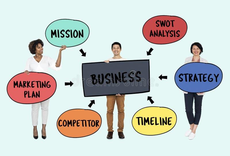 Επιχειρηματίες με ένα στρατηγικό σχέδιο στοκ εικόνα