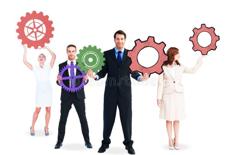 Επιχειρηματίες που κρατούν τα μεγάλα βαραίνω στοκ φωτογραφία